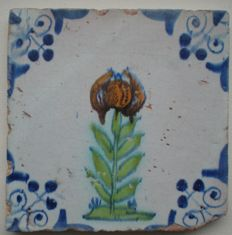 Antique tile with multicoloured flower (rare).