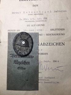 Third Reich World War II Wounded badge 1939 with a certificate and bag, Third Reich