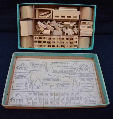 Very rare Russian (from USSR), box of wooden bricks with miniature houses, other building parts and vehicles, still in the original box, circa 1950
