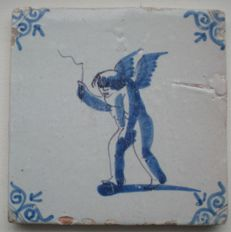 Antique tile with Cupid with a top