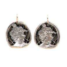 A pair Art Nouveau 14k gold and silver earrings.