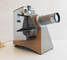 Leitz Prado SM - slide projector (with Dimaron f=10 cm, 1:2.8 projection objective and Leitz quick-swap slide holder), design award winner: industrial design