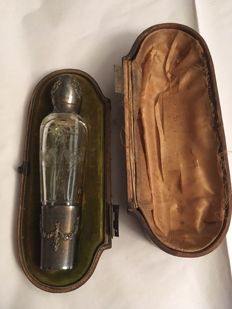 Engraved glass and silver travel bottle with original case, to be restored, France, early 20th century