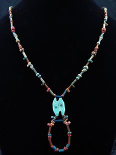 Egyptian necklace of faience beads and decorated double eye amulet - 53 cm