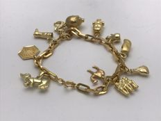 Bracelet with 11 different pendants CHARM BRACELET 750/18 kt yellow gold chain approx. 21 cm, total weight 27.6 G