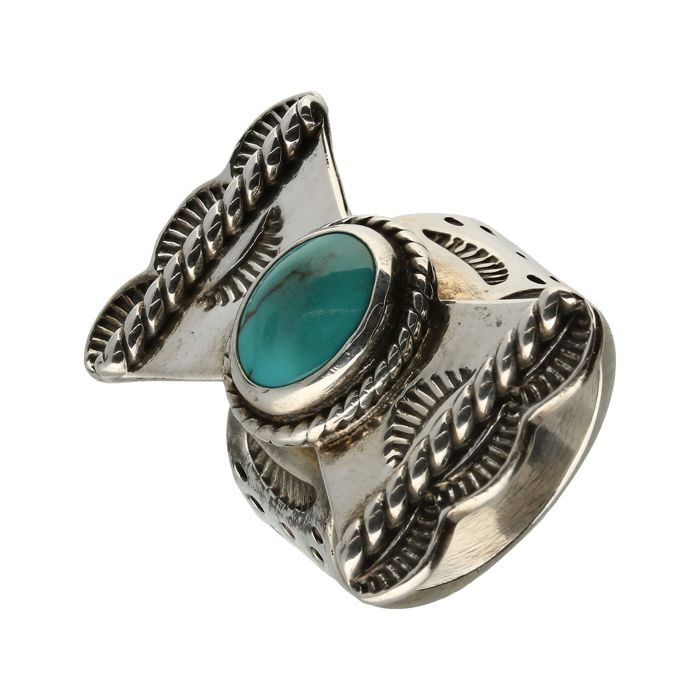 Silver ring set with a bow and a turquoise stone. - ring size ...