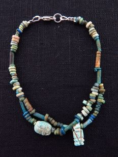 Egyptian double bracelet of faience beads with Taweret and decorated scarab amulet - 20 cm
