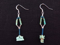 Set of Egyptian earrings with faience amulets of Nut as heavenly sow and Shu - 2 x 7 cm