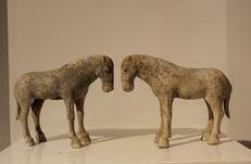 Pair of Panted Grey Pottery Figures of Grazing Horses.  21cm.