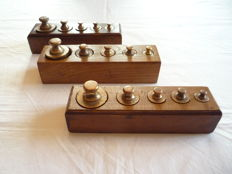 Three Dutch oak weights blocks with brass weights - The Netherlands - 19th and 20th century