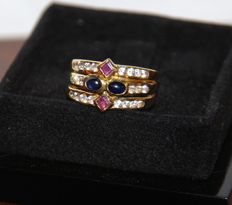 Ring in 18 kt gold with 2 sapphires, 2 amethysts and 22 brilliant cut diamonds. Size 18 mm