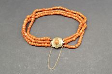 3 strand precious coral bracelet with a 14 kt gold clasp