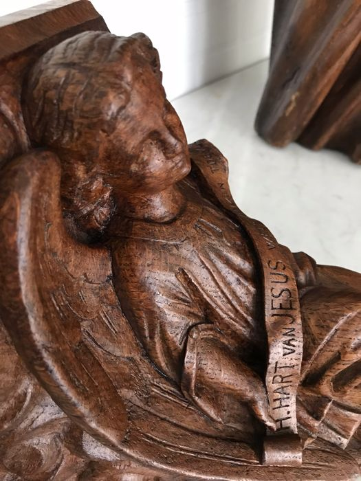 Richly carved oak console with winged angel - The Netherlands / Flanders - late 19th century