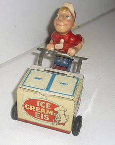 Hammerer & Kaka, U.S. zone Germany - height 10 cm - tin / mass ice cream seller with clockwork drive, 1950s