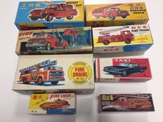 China, Korea, Japan - Length 12-27 cm - Large lot with 7 tin fire trucks and 1 Taxi with friction motor, 1960s/70s