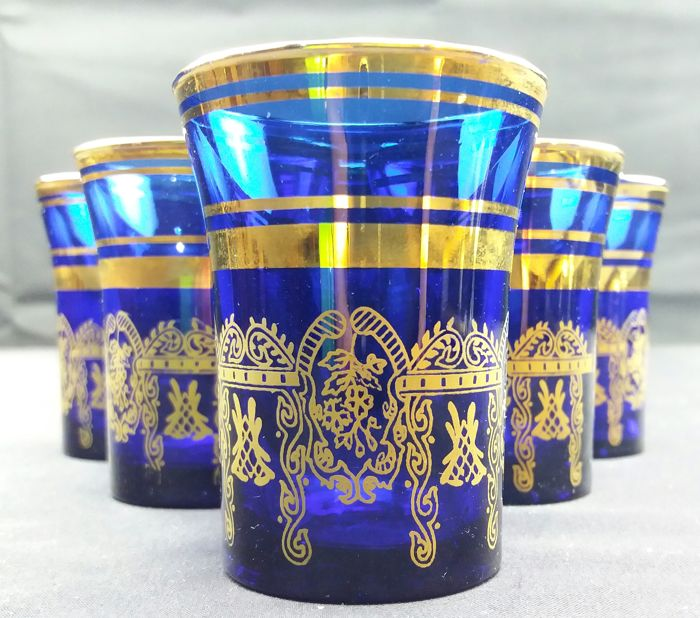 Set of 6 small glasses made of beautiful cobalt blue cut crystal with 24 kt gold decorations - France c. 1930