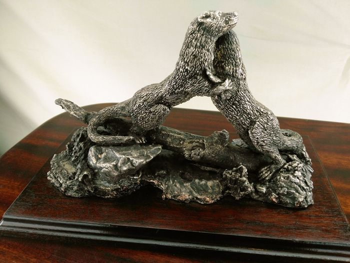 A silver sculpture of two fighting mongoose, England, Sheffield, 1986