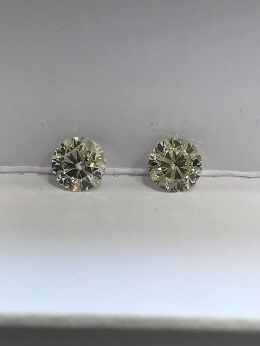 Pair of Round Brilliant Diamonds 1.01ct Total H-I SI1 EGL USA  #168-181