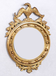 Butler [convex] mirror in gold-coloured frame with bird, in Regency style, h. 62 x w. 45 cm, 20th century
