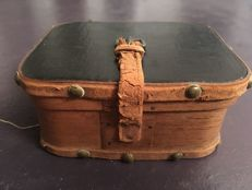Wooden suitcase with clothes for dolls