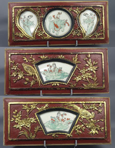 Three large Chinese wooden laquered panels with inserted porcelain plaques  , QING, Beginning 20th century