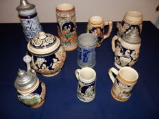 Collection of 9 beer steins and a pot in various sizes