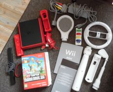 Wii Mini including 7 wii games like : Super Mario Bros + wii sports and more