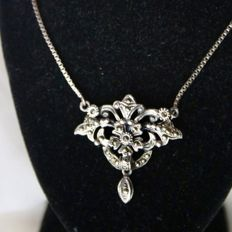 Ca. 1910/'20 Art Nouveau necklace reach decorated in flower and leaf design set with marquisette and hanging drop. Beautiful handcrafted.