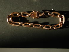 Arm band with 11 solid links and security clasp with 2 double on the back - 750 yellow gold - 19 cm