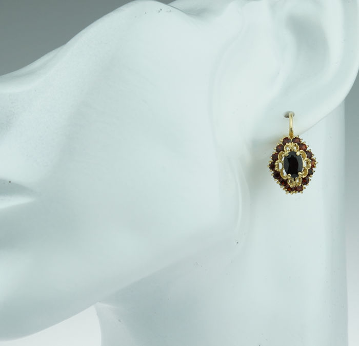 18 karat gold entourage earrings set with garnet - lovely design