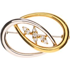 18 kt, Bi-colour gold brooch set with 7 round, brilliant cut diamonds approx. 0.19 ct in total