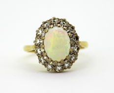 Vintage 18K Yellow Gold Ladies Ring With Opal (2 CT) and Diamonds (0.28 CT Total) 1979