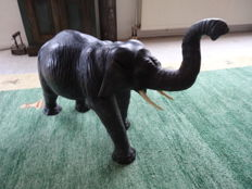 Elephant - sculpture made of leather and plastic (height 55 cm, length 82 cm and width 29 cm)