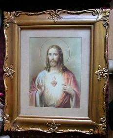 An old engraving of Sacred Heart of Jesus framed in a golden carving / 40 cm X 34 cm / Mid 20th Century