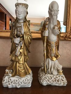 Two impressive, tall and heavy porcelain sculptures depicting a wise man and a woman - China - second half of 20th century