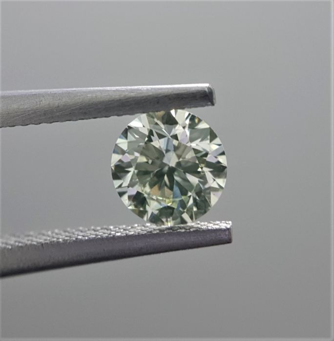 0.51ct Natural Round Brilliant Cut Diamond Light Yellow Green VS2