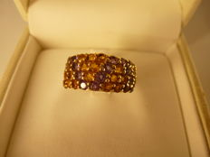 Ring in 18 kt gold with topazes and amethysts, size 54
