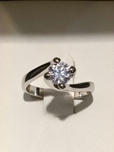 SOLITAIRE RING, 18 KT WHITE GOLD WITH GIA CERTIFIED 0.62 CT DIAMOND