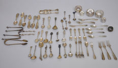Silver cake fork, several spoons, pair of sugar tongs and serviette rings, total of 58 items