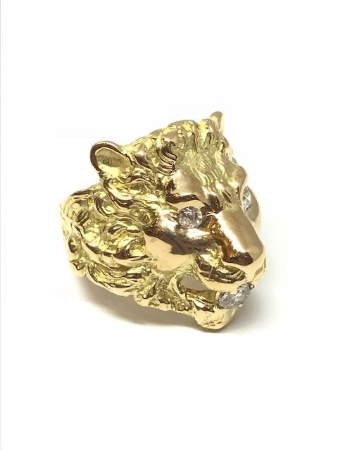 """Lion"" ring in 18 kt gold set with 2 0.1 ct diamonds in the eyes and 1 diamond of 0.47 ct in the mouth."