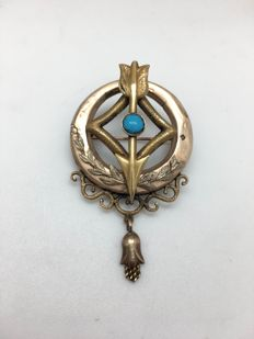 Brooch from the Bourbon period in 12 kt rose gold with a natural turquoise in the centre