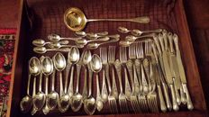 Silver cutlery set for 12 people including ladle. Russia, 20th century