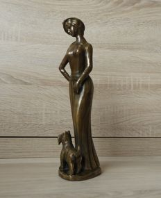 Brass sculpture of woman with terrier