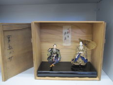 A fine pair of ningyo doll of a man and his servant, box with kyugetsu house seal - Japan - 1st half 20th century