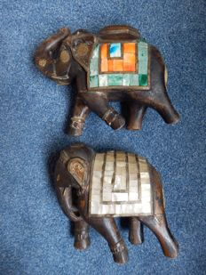 2 old wooden elephants with copper fittings