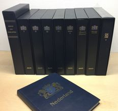 Netherlands - 9 Davo LX albums + case (partly with stamps) and 55 supplements to 2014