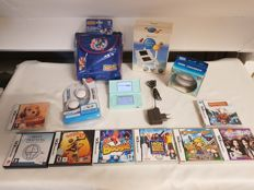 Complete Nintendo DS Lite with 8 games and accesoiries!