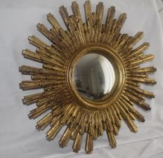 Authentic gold-coloured wooden sun mirror oeil de sorcière