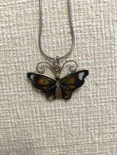 Silver butterfly pendant on necklace