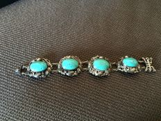 Chinese bracelet, large turquoise cabochons and sculpted silver ca.  1930; original silk and paper case